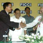 Felicitating CM at a FICCI meet
