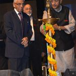 Lighting the lamp at a school centenary with the Governor of West Bengal