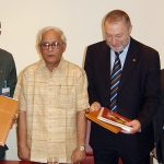 Kumar signing an MOU in Italy