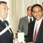 Being conferred knighthood by Italian Minister