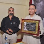 Kumar felicitated with a plaque on Tamil poem book release